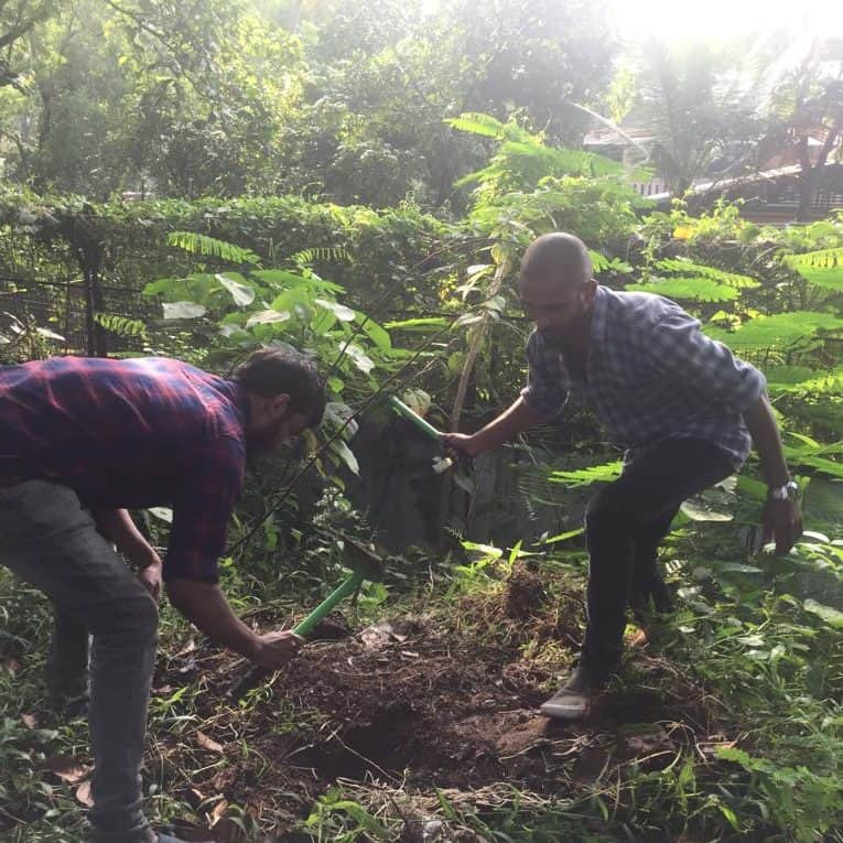 Harithapoorna planting trees by team members