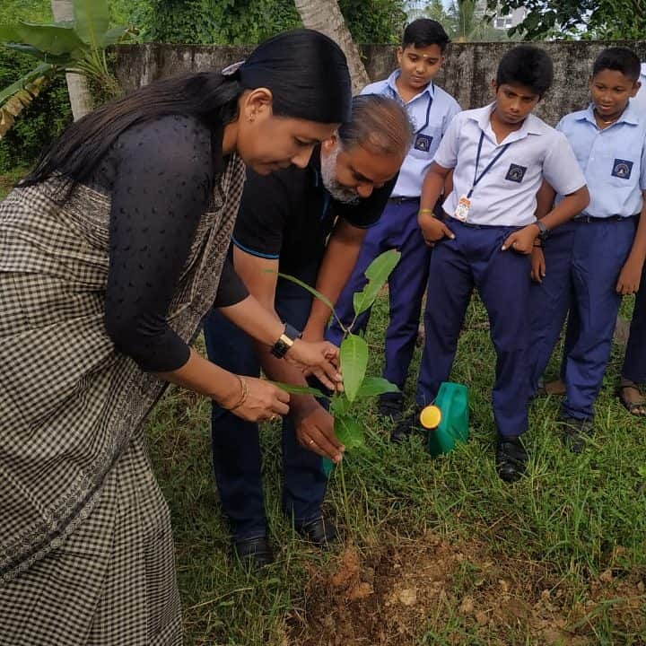 Harithapoorna planting trees